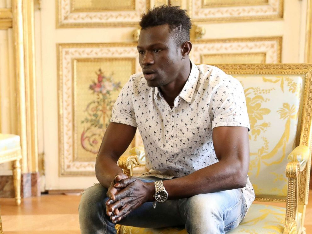 PHOTO: Mamoudou Gassama, 22, from Mali, meets with French President Emmanuel Macron at the presidential Elysee Palace in Paris, May, 28, 2018. Father of boy dangling from Paris balcony was out playing Pokémon Go, prosecutor says Father of boy dangling from Paris balcony was out playing Pokémon Go, prosecutor says mamadou gassama nc jt 180528 hpMain 4x3 992