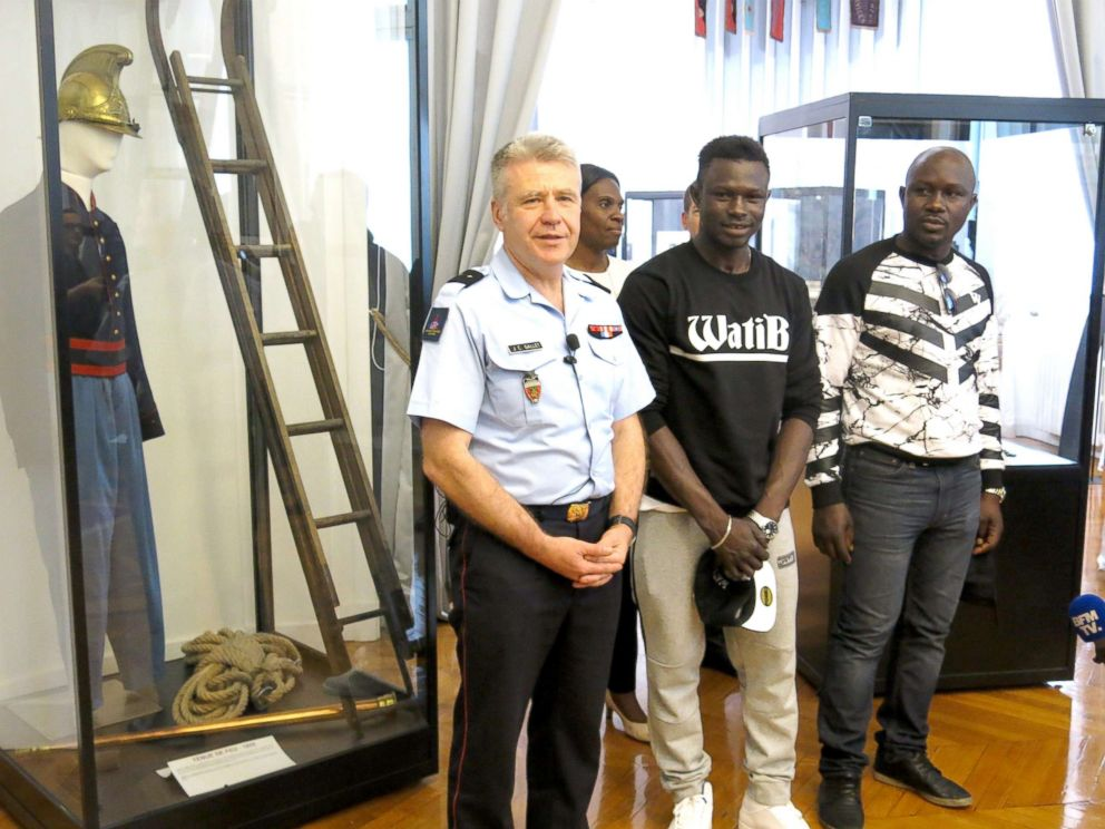 PHOTO: Mamoudou Gassama, who saved a child hanging off a balcony by scaling an apartment block with his bare hands, who received a medal and certificate for bravery, was asked to join the French fire service, May 29, 2018.  Man who rescued boy from balcony offered internship with Paris fire brigade mamaudou gassama hero fireman zp 2 thg 180530 hpMain 4x3 992