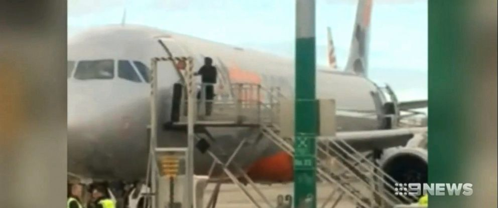 PHOTO: Framegrab from a video shows a passenger attempting to open the door to a jet and gain entry.