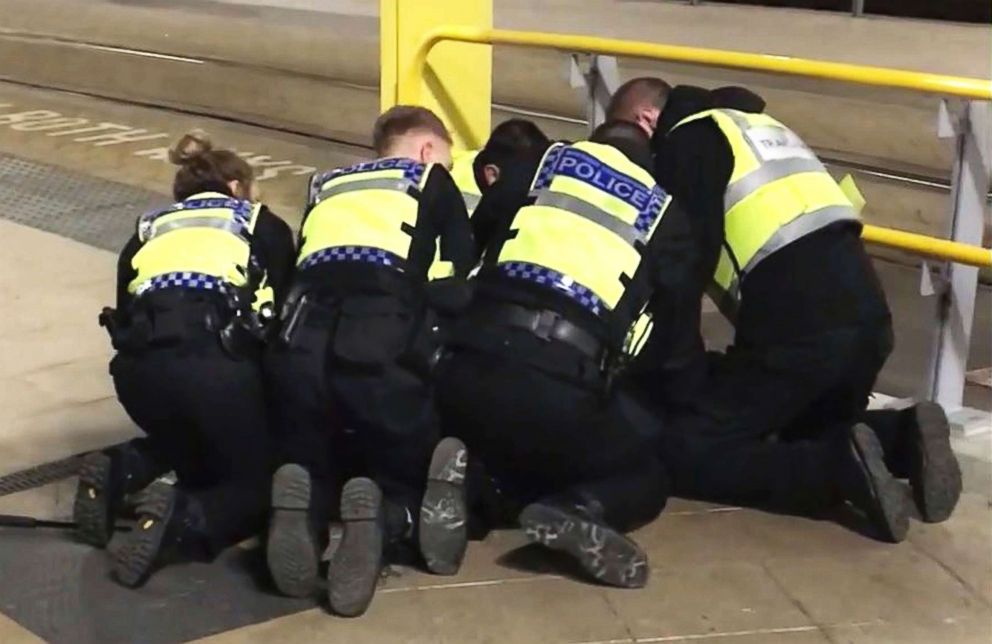 PHOTO: Police restrain a man after he allegedly stabbed three people at Victoria Station in Manchester, England, late Monday, Dec. 31, 2018.