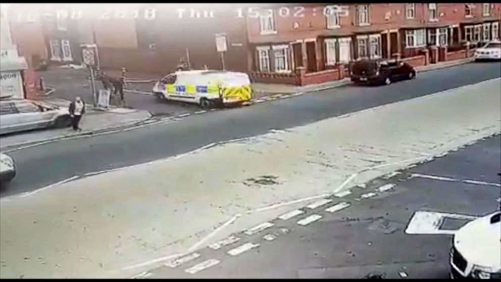 PHOTO: A police officer was taken to the hospital after he was accidentally hit by a police van in Salford, England.