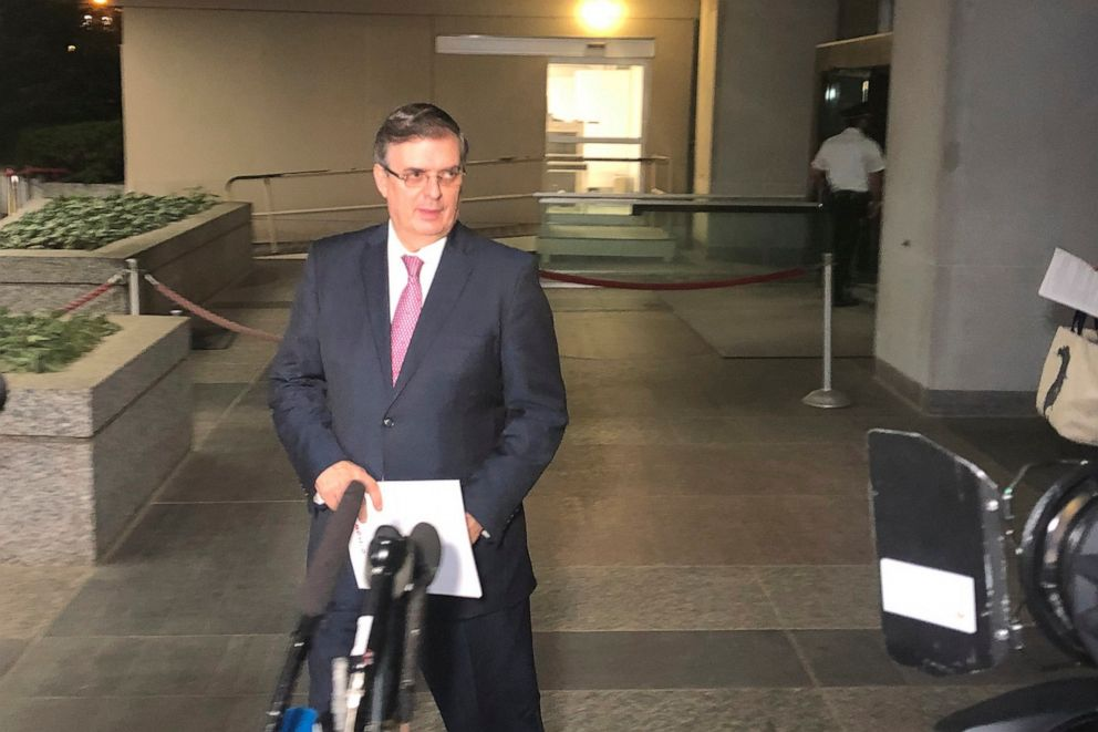 PHOTO: Mexican Foreign Minister Marcelo Ebrard gets ready to talk to reporters as he leaves the Department of State in Washington, on Friday June 7, 2019.