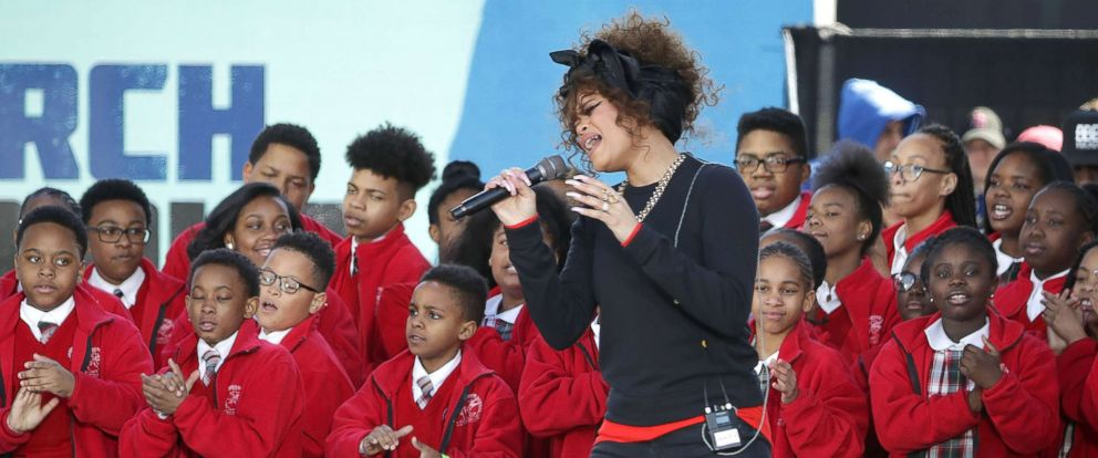 """PHOTO: Andra Day performs """"Rise Up"""" with members of the Cardinal Shehan School Choir during the March for Our Lives rally, on March 24, 2018 in Washington, D.C."""