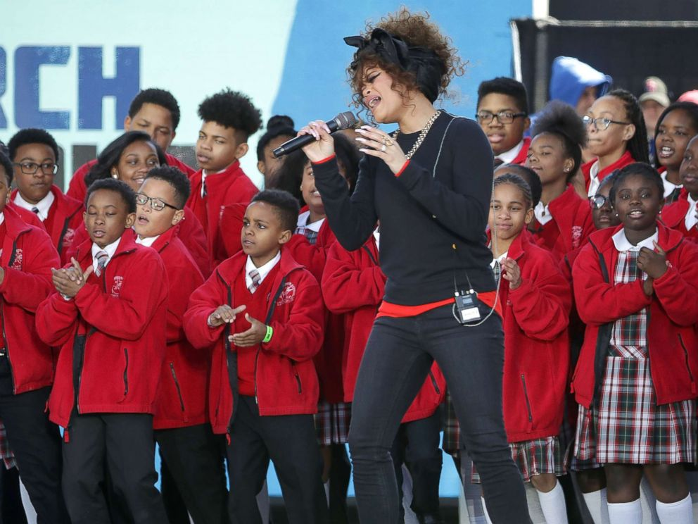 PHOTO: Andra Day performs Rise Up with members of the Cardinal Shehan School Choir during the March for Our Lives rally, on March 24, 2018 in Washington, D.C.