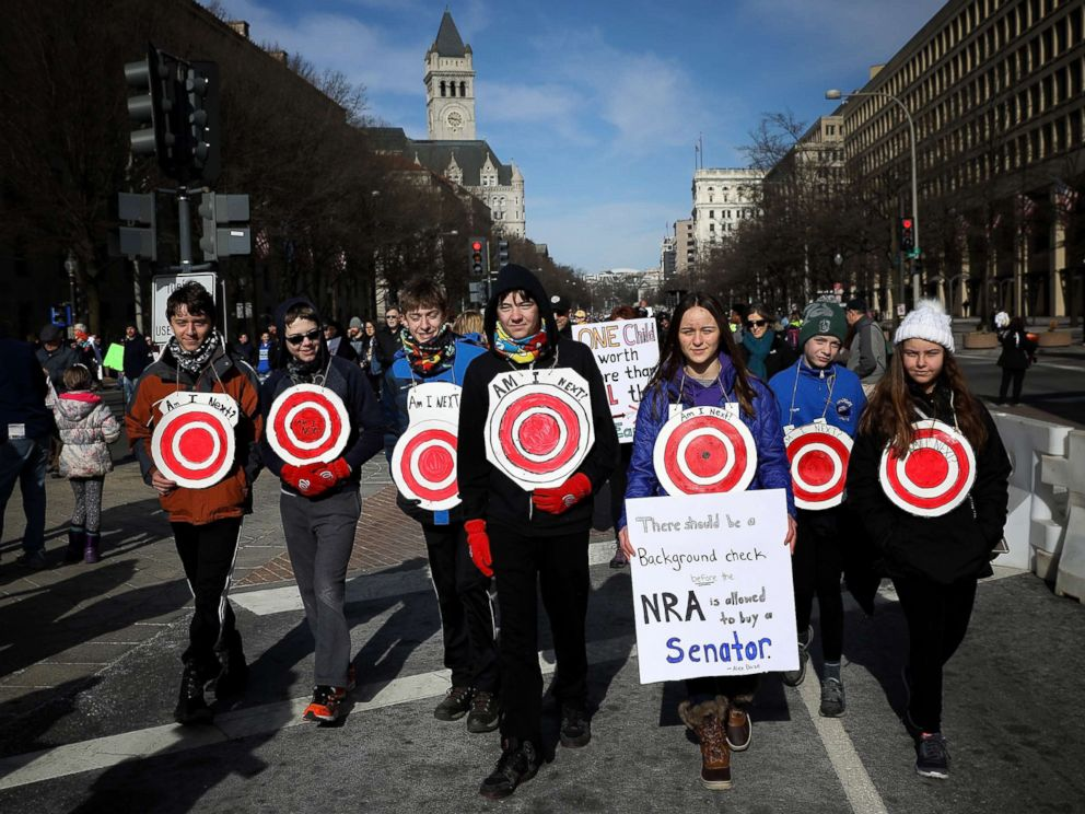 PHOTO: Students from Centreville, Virginia wear targets on their chests as they arrive for the March for Our Lives rally, March 24, 2018 in Washington, D.C.