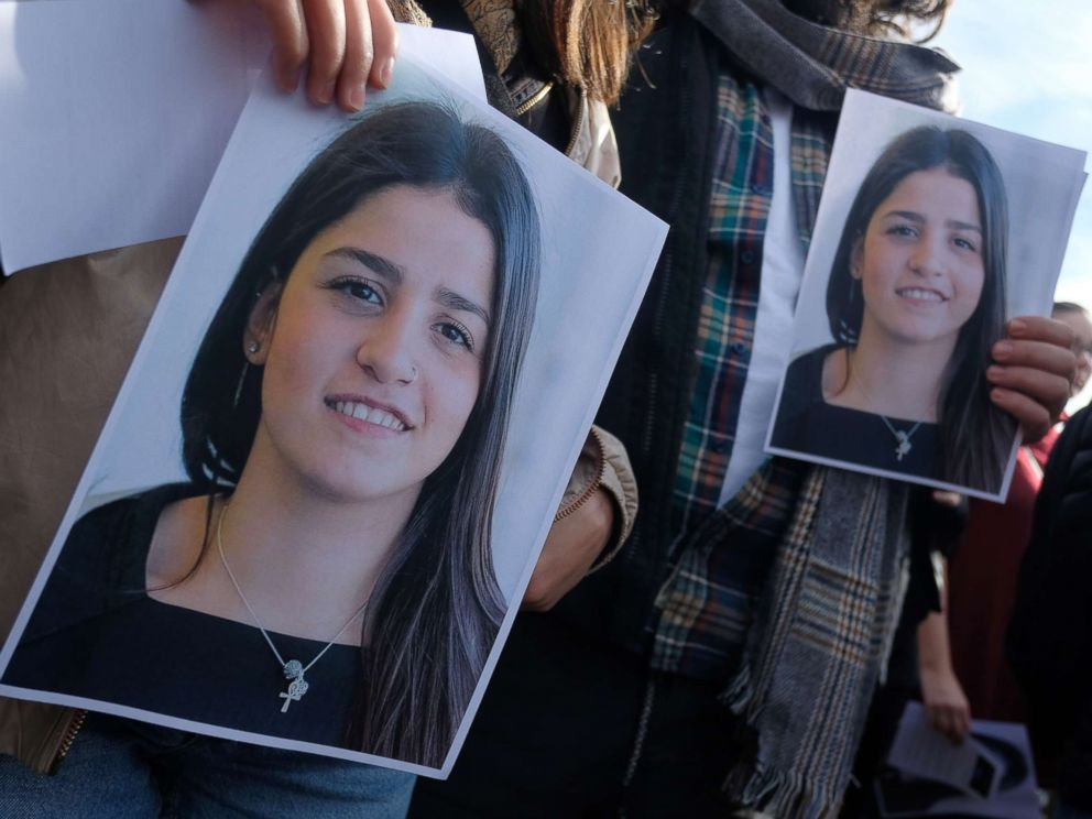 PHOTO: Students from Bard College hold up a photograph of their classmate Sara Mardini, a Syrian refugee who is being held in Greece on charges of people smuggling and spying, during a demonstration to demand her release, Oct. 20, 2018, in Berlin.