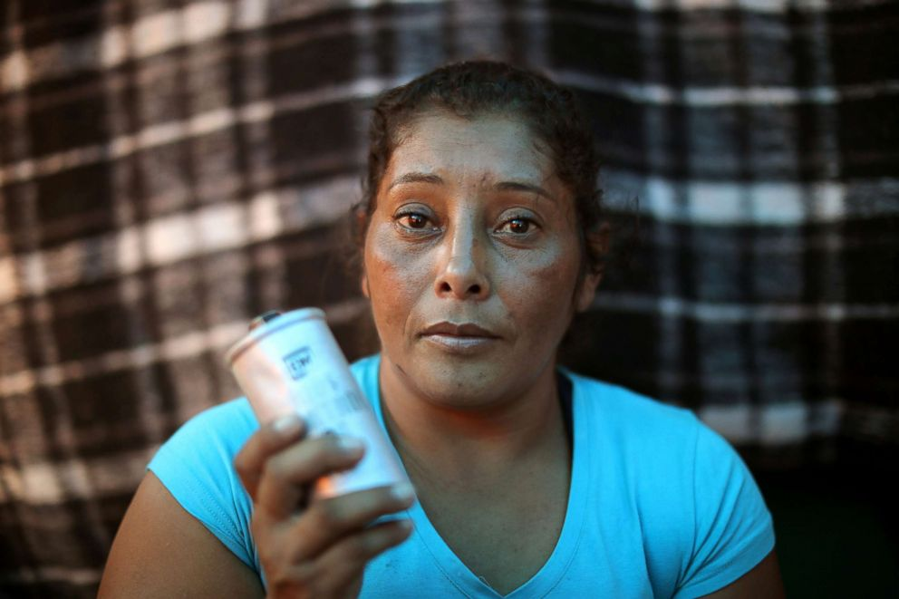 PHOTO: Maria Meza poses for a photo with a tear gas canister that she picked up as she sits in her tent at a temporary shelter in Tijuana, Mexico, Nov. 26, 2018.