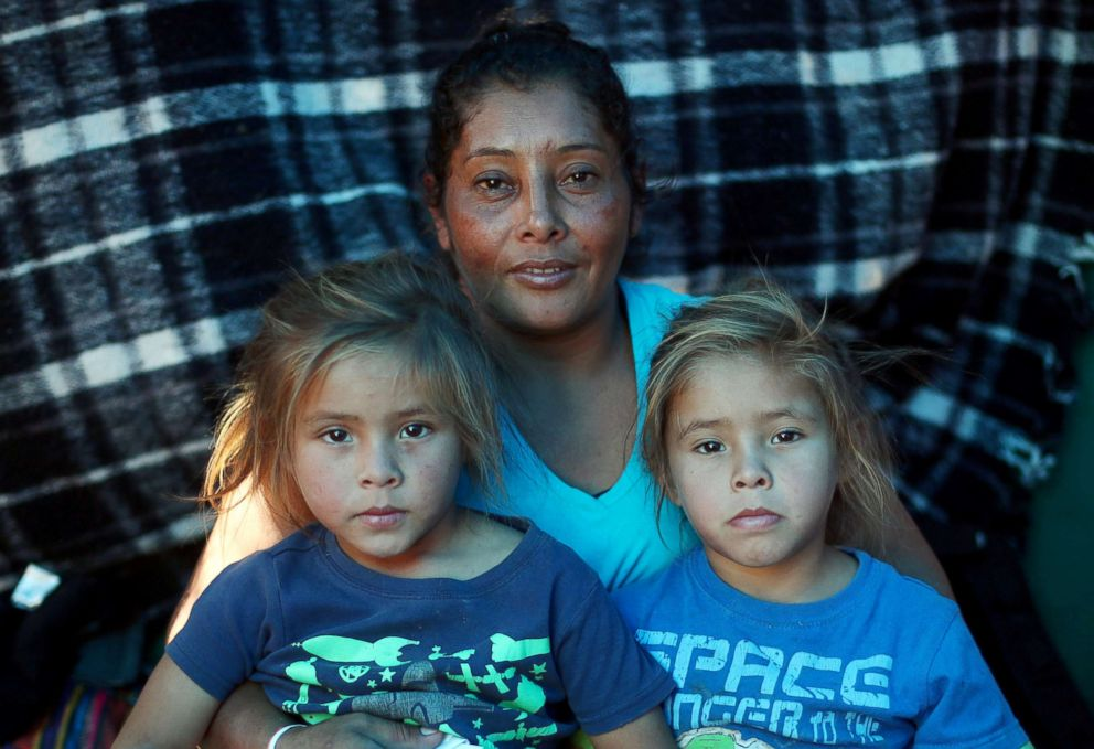 PHOTO: Maria Meza sits with her five-year-old twin daughters Cheili Mejia Meza and Saira Mejia Meza inside their tent in a temporary shelter in Tijuana, Mexico, Nov. 26, 2018.