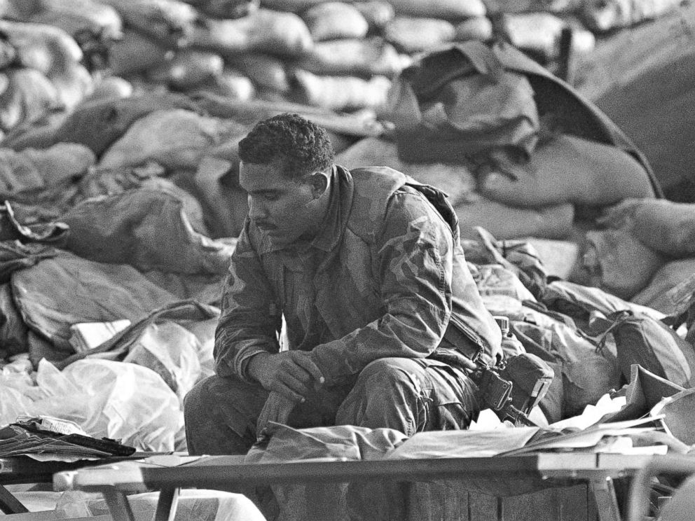 PHOTO: U.S. Marine rests, Oct. 25, 10983, at the site of a truck bombing that leveled the Marine command center on Oct. 23. The Marine was part of the search team.