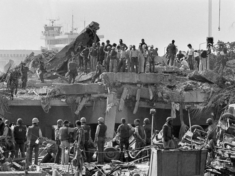 PHOTO: Rescuers probe the wreckage of the U.S. Marine barracks near the Beirut airport, a day after a suicide truck bombing, Oct. 24, 1983.