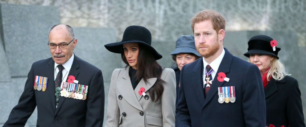 PHOTO: Prince Harry (2R) and Meghan Markle attend an Anzac Day dawn service at Hyde Park Corner, April 25, 2018, in London.