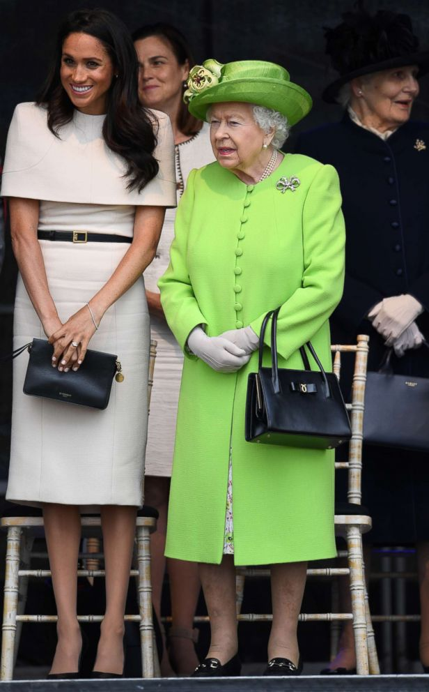 PHOTO: Queen Elizabeth II stands with Meghan, Duchess of Sussex during a ceremony to open the new Mersey Gateway Bridge, June 14, 2018, in the town of Widnes in Halton, Cheshire, England.