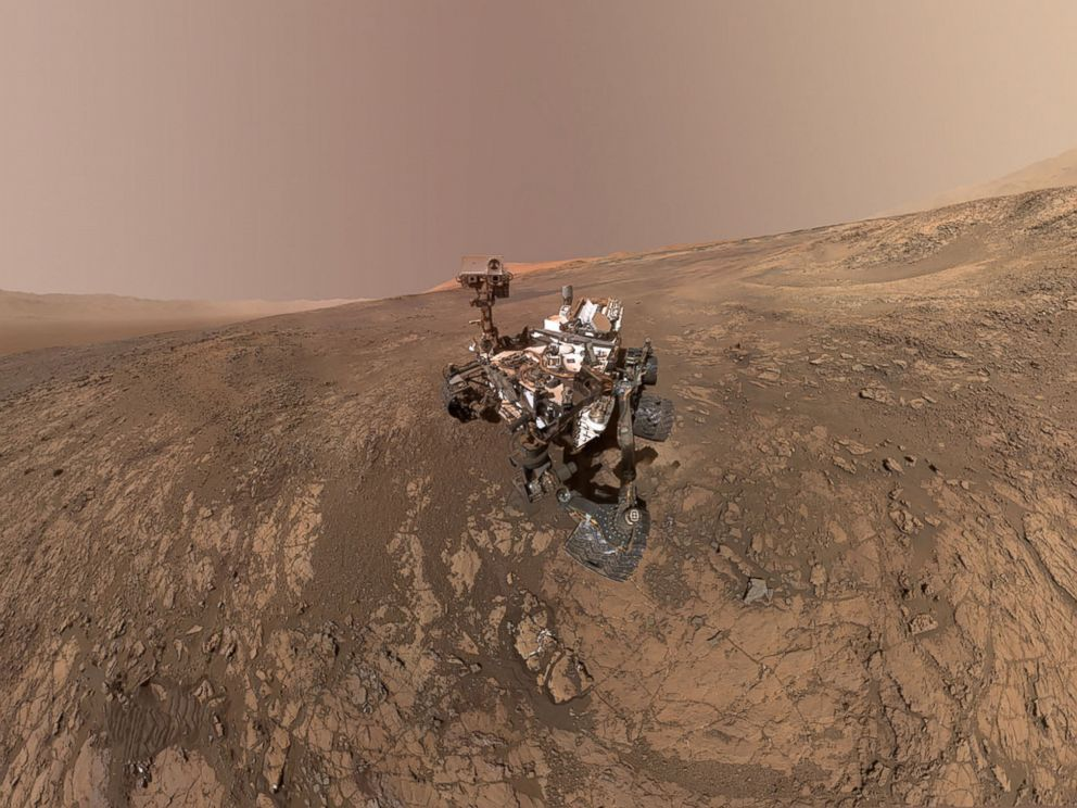 PHOTO: This NASA photo taken on Feb. 4, 2018, is a self-portrait of NASAs Curiosity Mars rover on Vera Rubin Ridge. Directly behind the rover is Gale Craters rim.