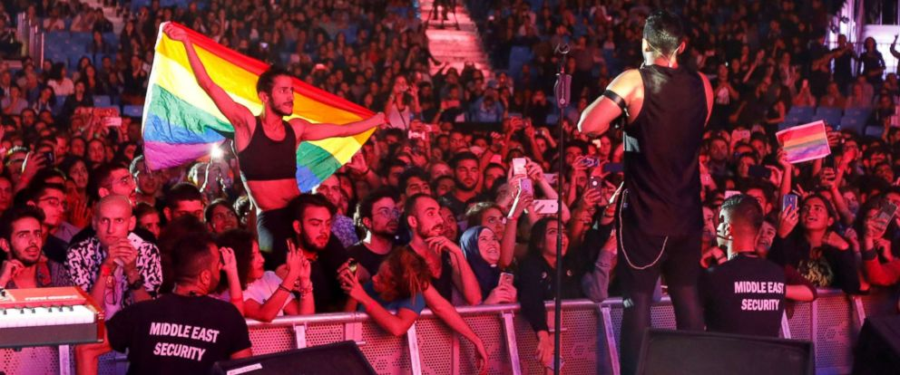 PHOTO: A fan of Lebanese alternative rock band Mashrou Leila holds a rainbow flag during their concert at the Ehdeniyat International Festival in Ehden town, Lebanon, Aug. 12, 2017.