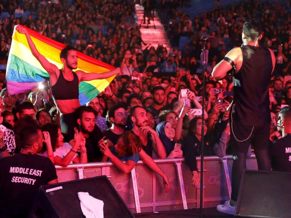 PHOTO: A fan of Lebanese alternative rock band Mashrou Leila holds a rainbow flag during their concert at the Ehdeniyat International Festival in Ehden town, Lebanon, Aug. 12, 2017.