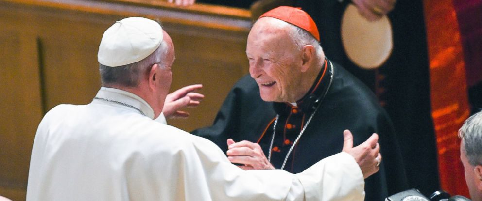 In this Sept. 23, 2015 file photo, Pope Francis reaches out to hug Cardinal Archbishop emeritus Theodore McCarrick after the Midday Prayer of the Divine with more than 300 U.S. Bishops at the Cathedral of St. Matthew the Apostle in Washington.