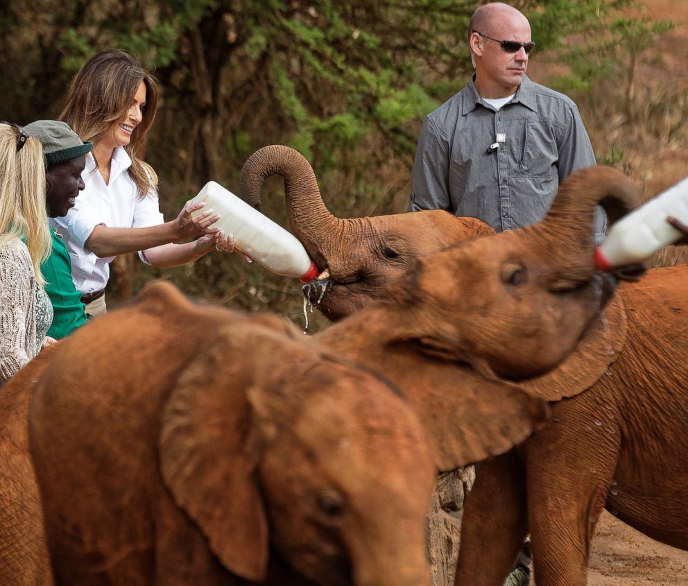 First lady Melania Trump feeds a baby elephant milk at the David Sheldrick Wildlife Trust Elephant Orphanage in Nairobi, Kenya, Oct. 5, 2018.