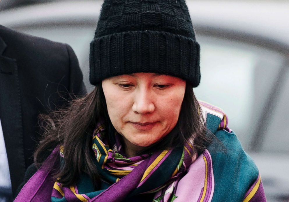 PHOTO: Huawei chief financial officer Meng Wanzhou arrives at a parole office with a security guard in Vancouver, British Columbia, Dec. 12, 2018.