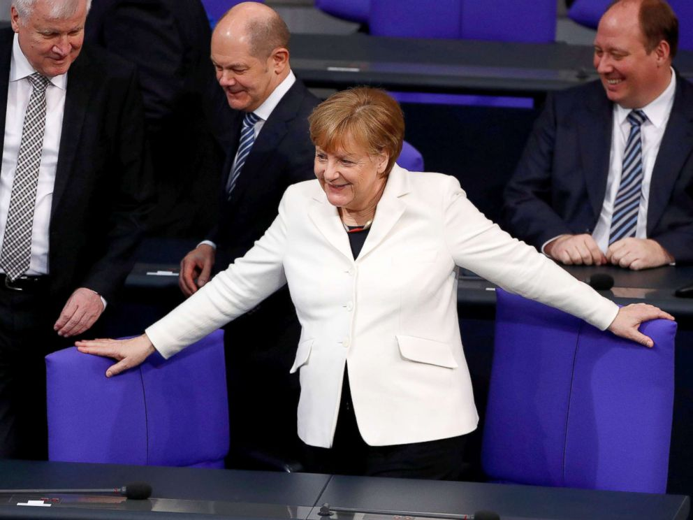 PHOTO: German Chancellor Angela Merkel takes her seat before the swearing-in ceremony of her government in Germanys lower house of parliament Bundestag in Berlin, Germany, March 14, 2018.