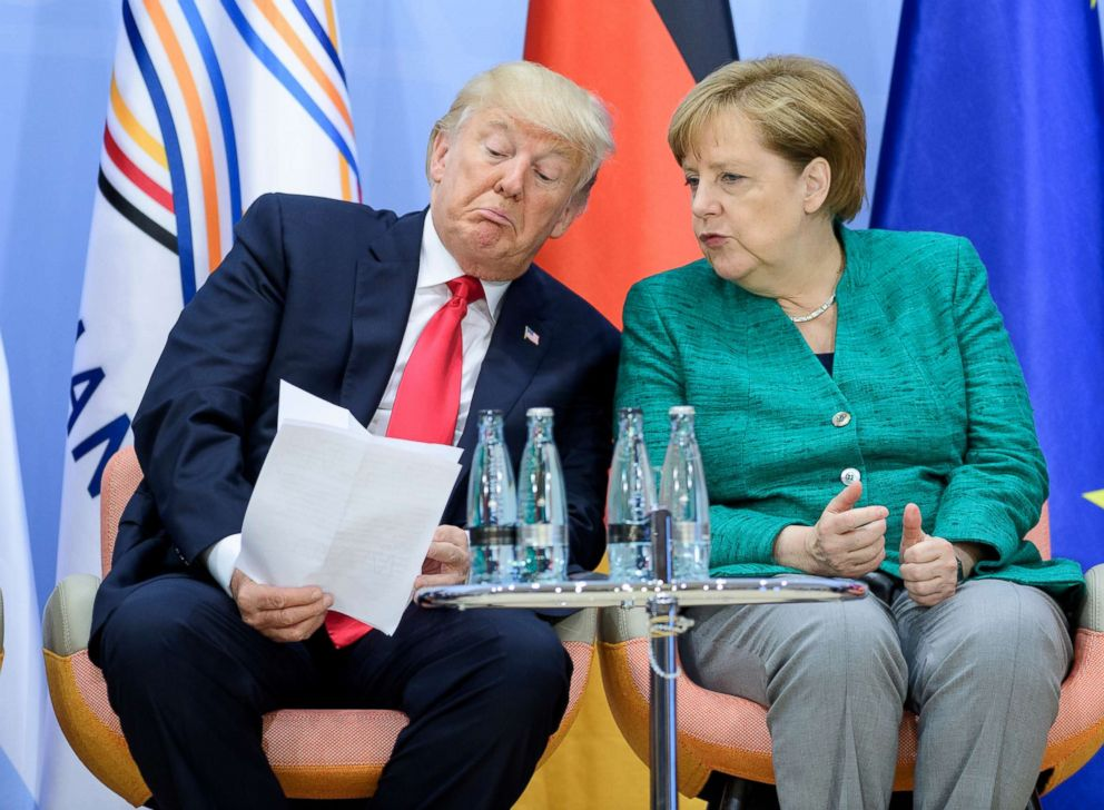 PHOTO: President Donald Trump and German Chancellor Angela Merkel attend a panel discussion on the second day of the G20 summit, July 8, 2017 in Hamburg, Germany.
