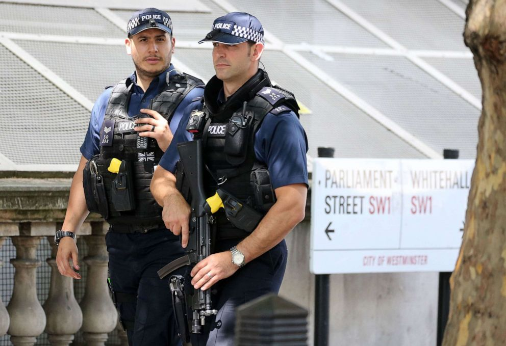PHOTO: Armed British Metropolitan Police officers carry their guns as they patrol on Whitehall in central London on May 23, 2019.