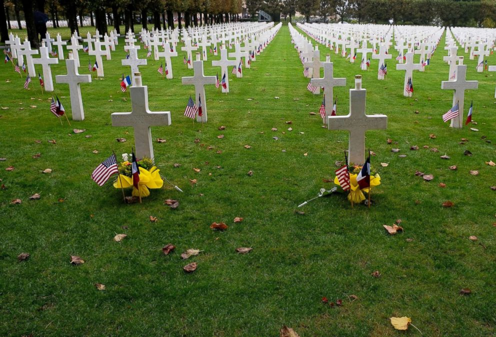 PHOTO: Gravestones are decorated with American flags at the Meuse-Argonne American Cemetery and Memorial in Romagne-sous-Montfaucon, France, Sept. 23, 2018, after a commemoration ceremony marking the 100th anniversary of the Meuse-Argonne Offensive.