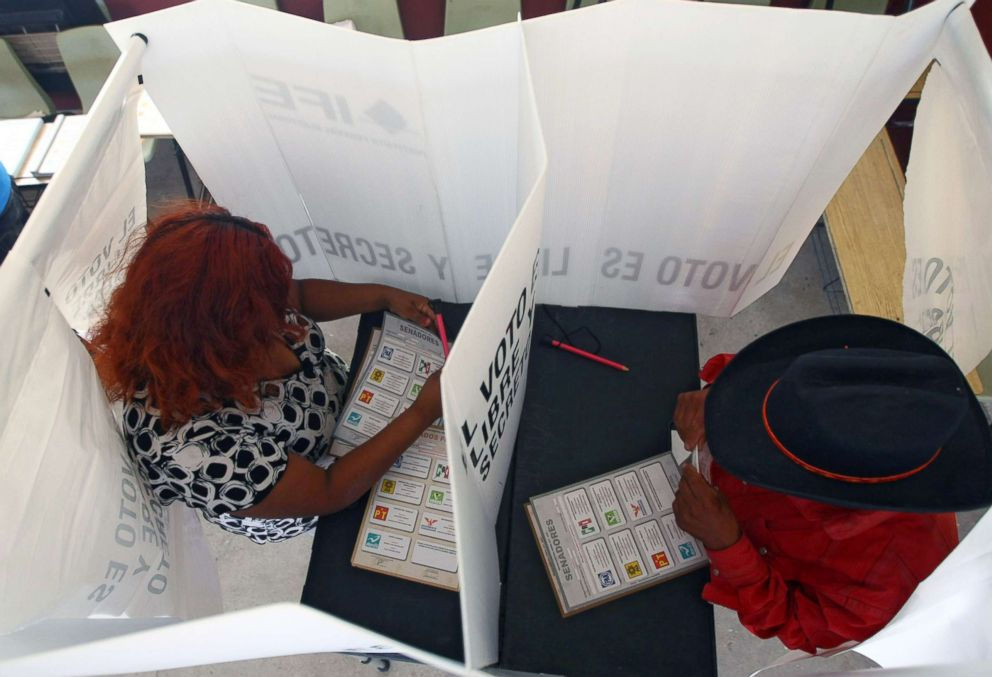 PHOTO: Mexicans vote at a polling station during elections on July 1, 2012, in Ciudad Juarez, Mexico.