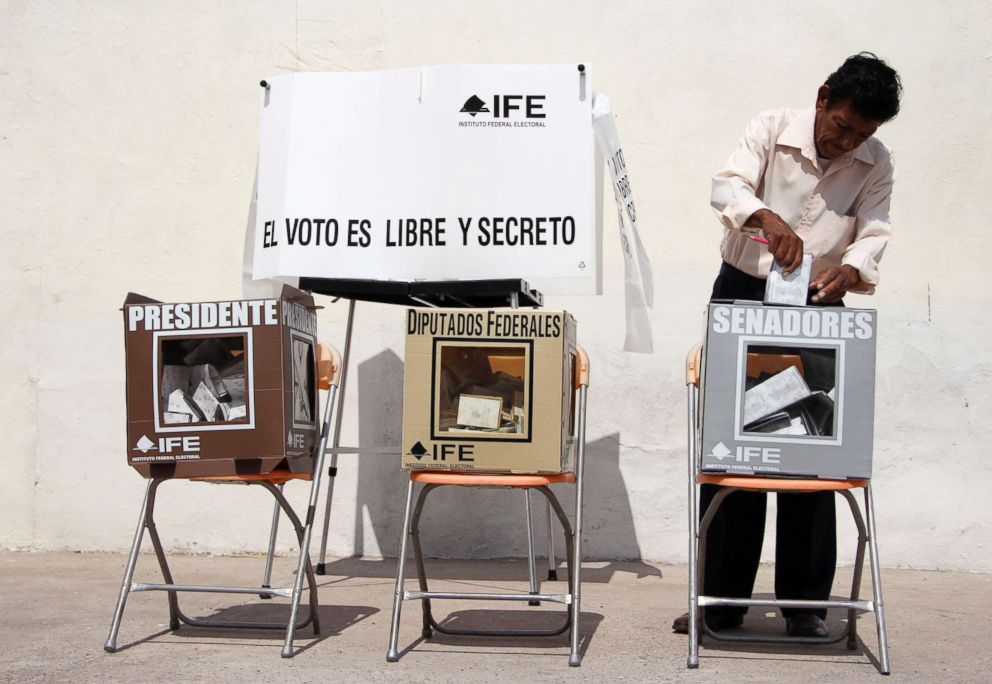 PHOTO: A man casts his vote at a polling station in Ciudad Juarez, Mexico, July 1, 2012.