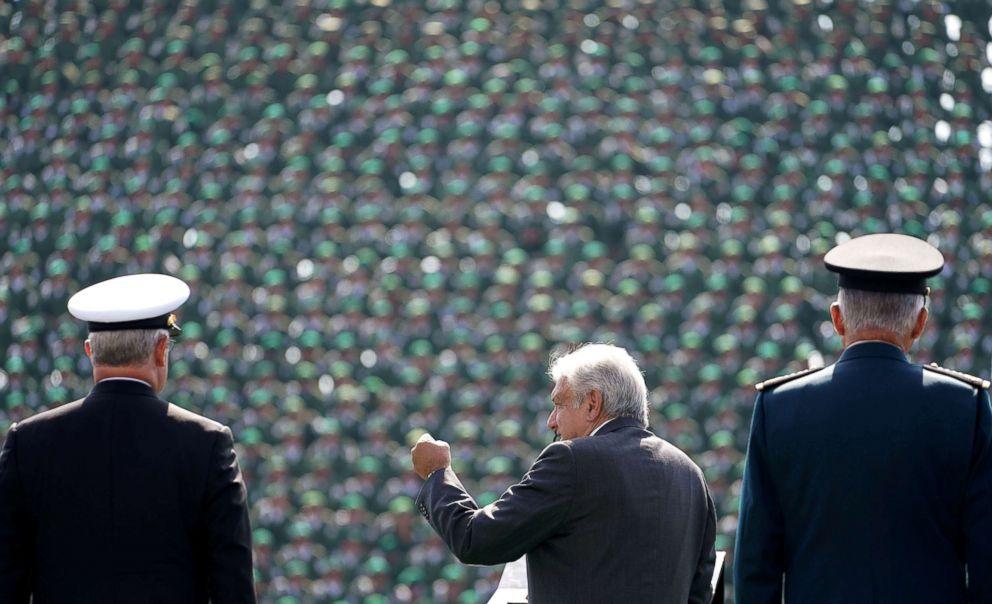 PHOTO: Mexican President-elect Andres Manuel Lopez Obrador, flanked by Defense Minister General Salvador Cienfuegos and Secretary of the Navy Admiral Vidal Francisco Soberon, addresses troops at Military Camp 1, in Mexico City, Mexico Nov. 25, 2018.