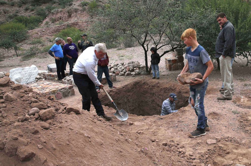 PHOTO: Men dig a mass grave for some of the women and children related to the extended LeBaron family before their burial at the cemetery in La Mora, Sonora state, Mexico, Nov. 7, 2019.