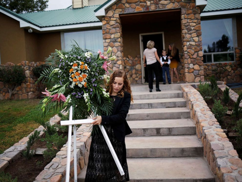 PHOTO: A relative carries a wreath before the funeral of Dawna Ray Langford and her two children, members of the Mexican-American Mormon community killed by unknown assailants, in La Mora, Sonora state, Mexico, Nov. 7, 2019.