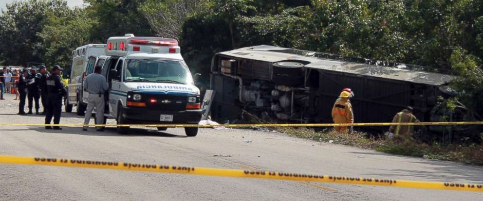 PHOTO: An ambulance sits parked next to an overturned bus in Mahahual, Quintana Roo state, Mexico, Dec. 19, 2017.