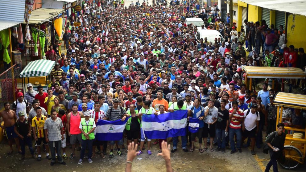 Honduran migrants heading in a caravan to the U.S., hold a demonstration demanding authorities to allow the rest of the group to cross, in Ciudad Hidalgo, Chiapas, Mexico after crossing from Guatemala, on Oct. 20, 2018.