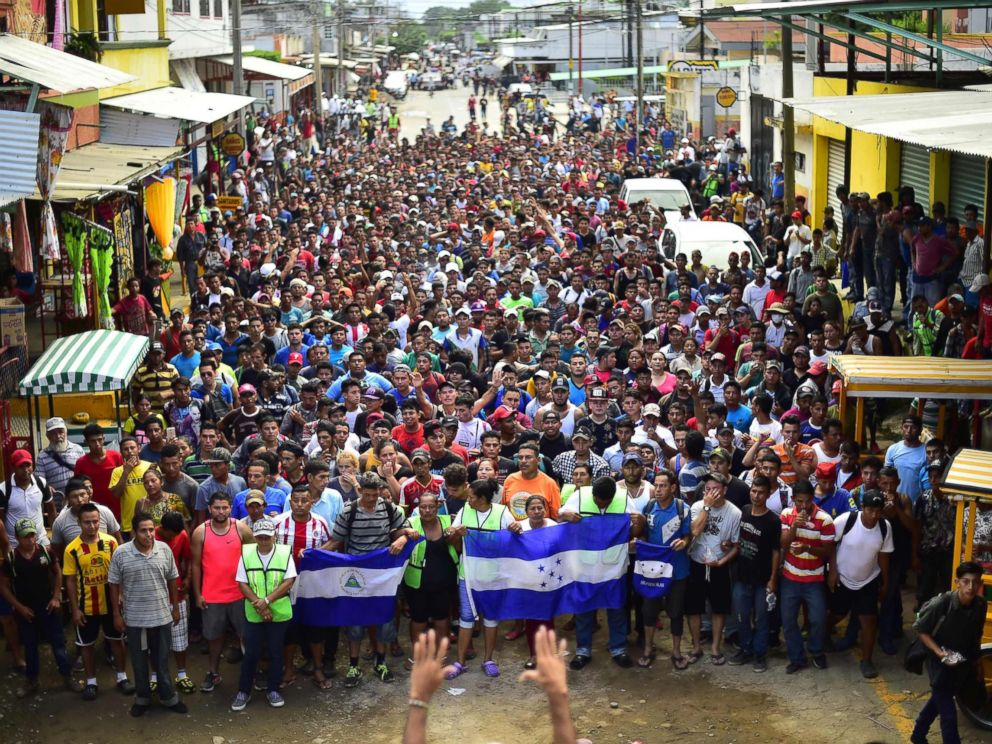 PHOTO: Honduran migrants heading in a caravan to the U.S., hold a demonstration demanding authorities to allow the rest of the group to cross, in Ciudad Hidalgo, Chiapas, Mexico after crossing from Guatemala, on Oct. 20, 2018.