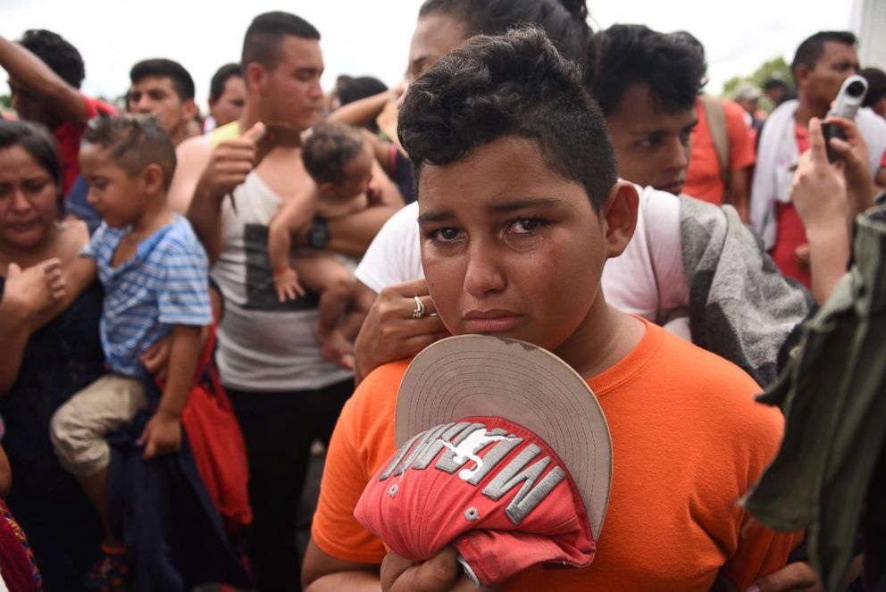 PHOTO: A Honduran migrant boy taking part in a caravan heading to the U.S., cries as he waits on the Guatemala-Mexico border bridge, in Ciudad Tecun Uman, Guatemala, on Oct. 20, 2018.