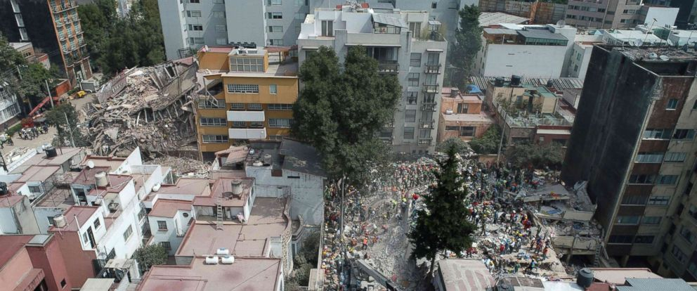 PHOTO: Aerial view showing as rescuers, firefighters, policemen, soldiers and volunteers search for survivors in a flattened building in Mexico City on Sept. 20, 2017 a day after a 7.1 earthquake hit central Mexico.