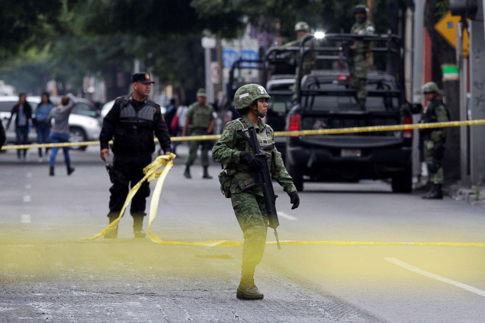 PHOTO: A female soldier guards a crime scene where unknown assailants gunned down a couple inside a restaurant in Monterrey, Mexico, April 10, 2018.
