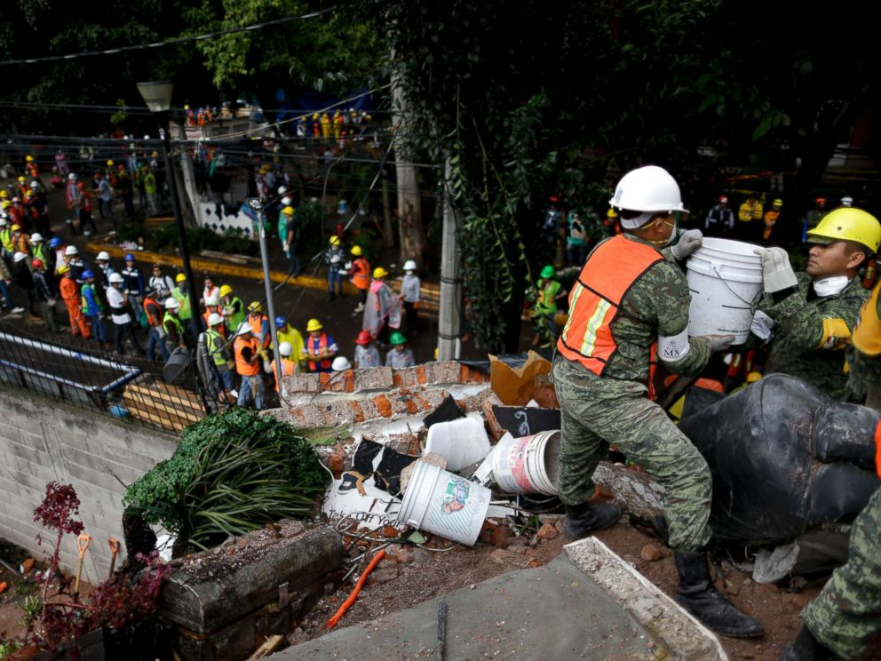 PHOTO: Rescue workers search for survivors at an apartment building that collapsed after an earthquake in Mexico City, Mexico, Sept. 21, 2017.