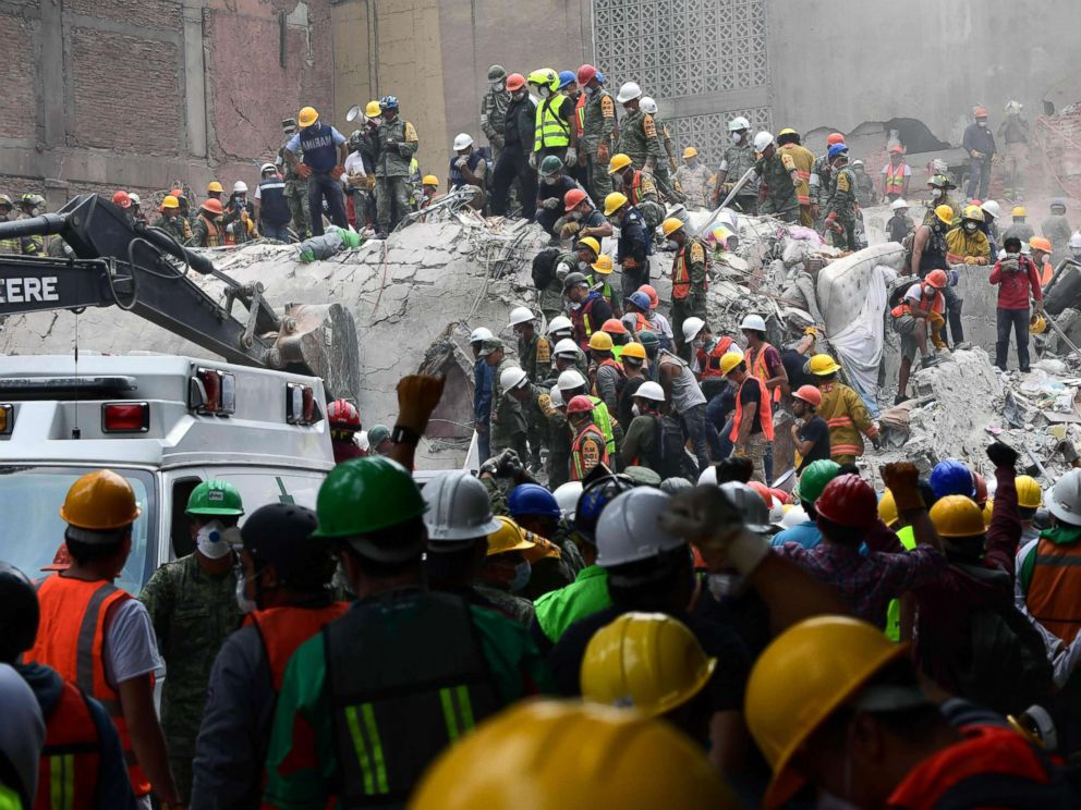 PHOTO: Rescue workers and volunteers search for survivors in a toppled building in Mexico City, Sept. 21, 2017.