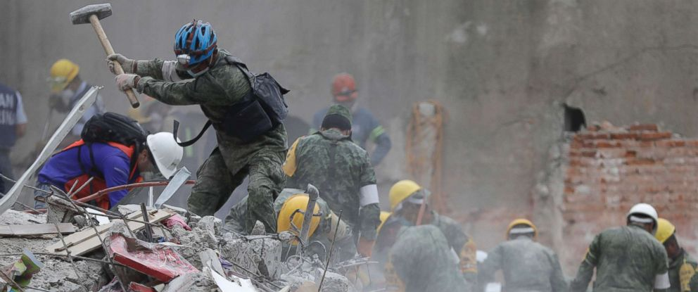 PHOTO: Rescue workers search for survivors at an apartment building located on Amsterdam street, at the intersection with Laredo street, that collapsed during an earthquake in the Condesa neighborhood of Mexico City, Sept. 21, 2017.