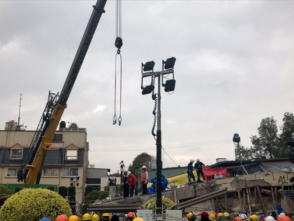 PHOTO: Rescue workers use a crane to lift parts of building that was destroyed by an earthquake in hopes to find survivors, Sept. 21, 2017, in Mexico City.