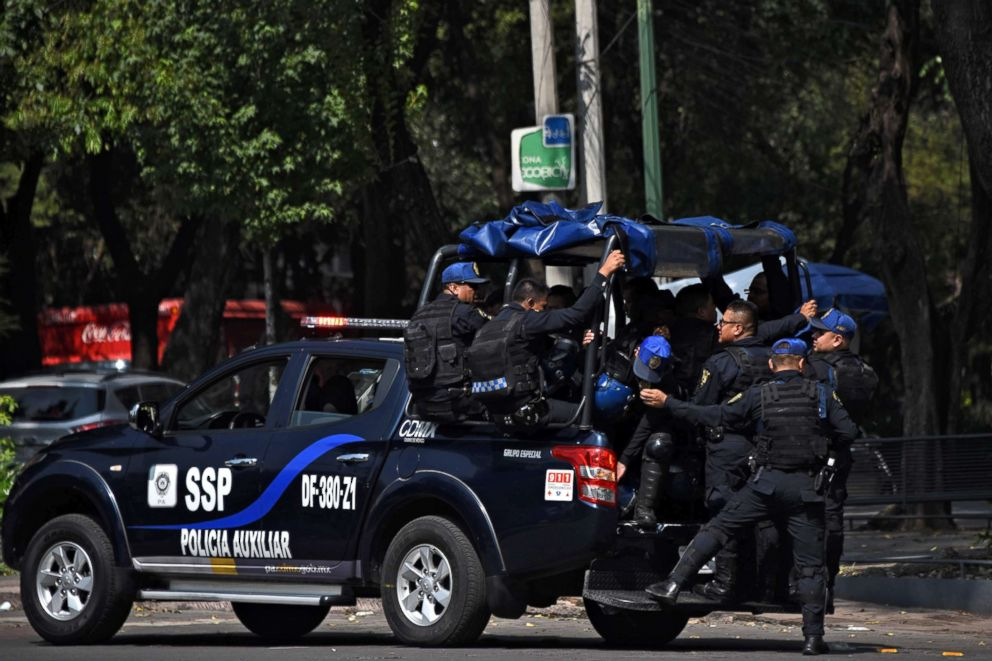 PHOTO: Policemen patrol the streets of Mexico City on June 29, 2018, ahead of the upcoming July 1 presidential election.