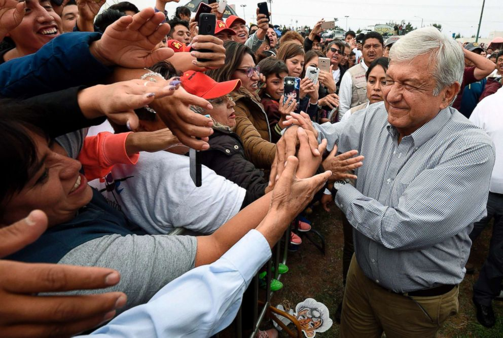 PHOTO: Mexicos presidential candidate Andres Manuel Lopez Obrador greets supporters during a campaign rally in Los Reyes Acaquilpan, Mexico, June 20, 2018 ahead of the upcoming July 1 national election.