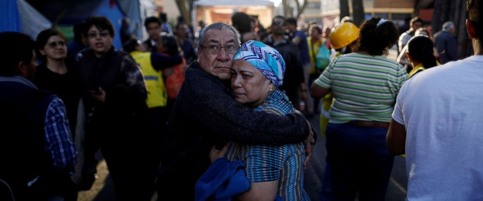 PHOTO: People react after an earthquake shook buildings in Mexico City, Feb. 16, 2018.