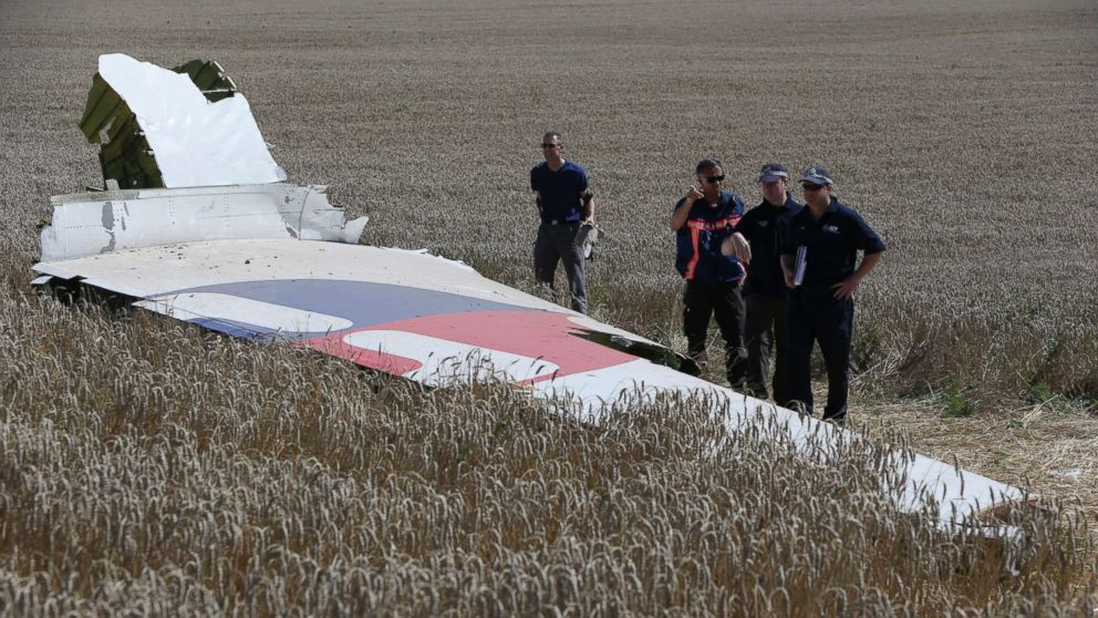 Members of a group of international experts inspect wreckage at the site where the downed Malaysia Airlines flight MH17 crashed in eastern Ukraine, Aug. 1, 2014.