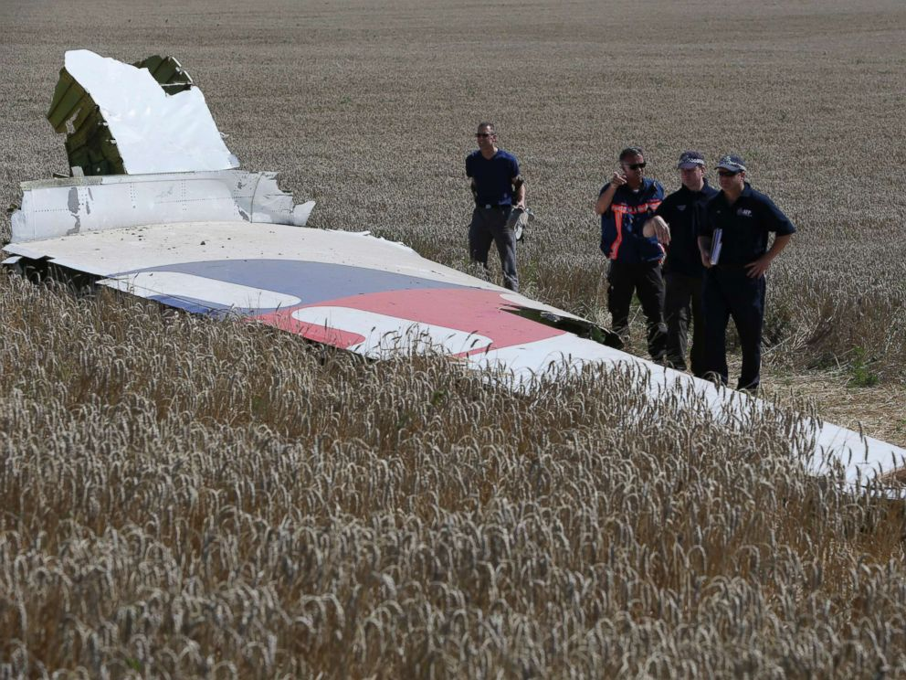 PHOTO: Members of a group of international experts inspect wreckage at the site where the downed Malaysia Airlines flight MH17 crashed in eastern Ukraine, Aug. 1, 2014.