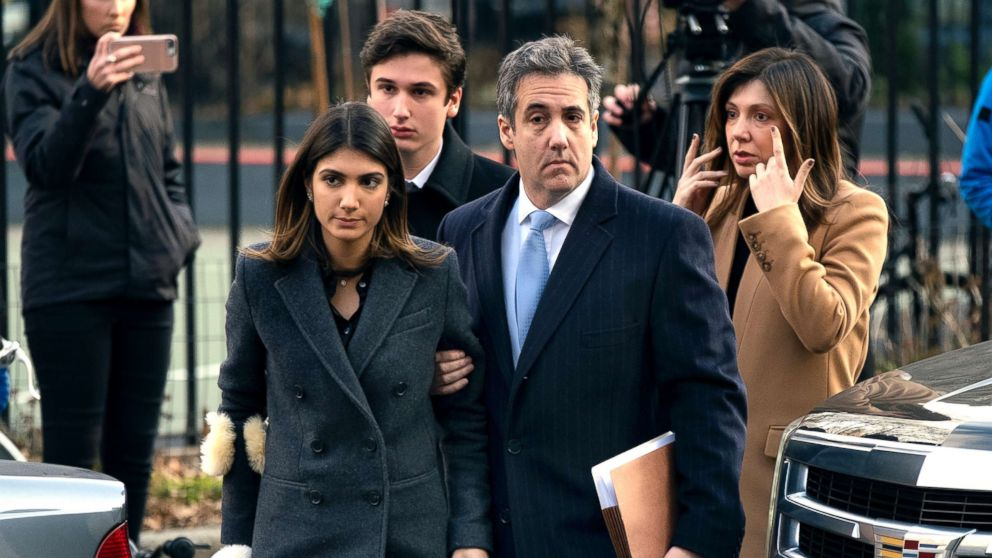 Michael Cohen, right, President Donald Trump's former lawyer, accompanied by his children and wife, arrive at federal court for his sentencing in New York, Dec. 12, 2018.