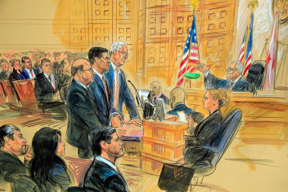 PHOTO: This courtroom sketch depicts President Donald Trumps former national security adviser Michael Flynn, standing center, flanked by his lawyers, listening to U.S. District Judge Emmet Sullivan, right in Washington D.C., Dec. 18, 2018.