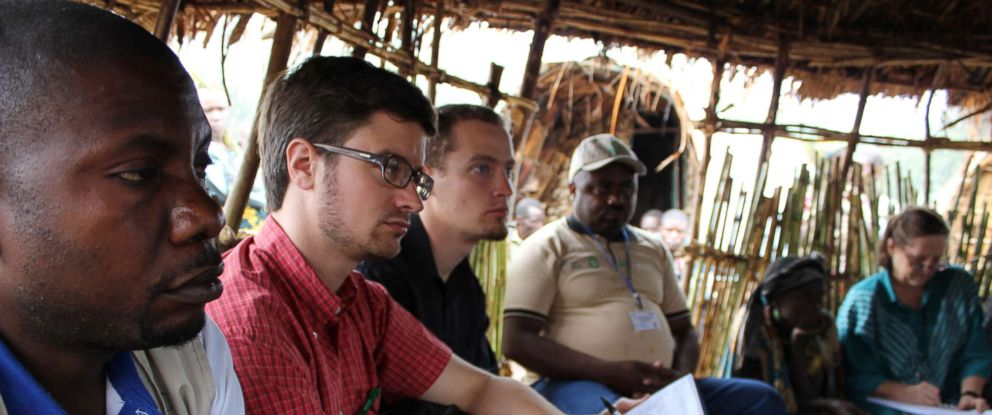 PHOTO: Michael Sharp, second from the left, is pictured in the Shasha camp for internally displaced persons in North Kivu, eastern Democratic Republic of the Congo, in September 2013.