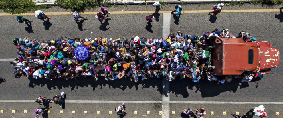 PHOTO: Aerial view of Honduran migrants on board a truck as they take part in a caravan heading to the US, in the outskirts of Tapachula, on their way to Huixtla, Chiapas state, Mexico, on Oct. 22, 2018.
